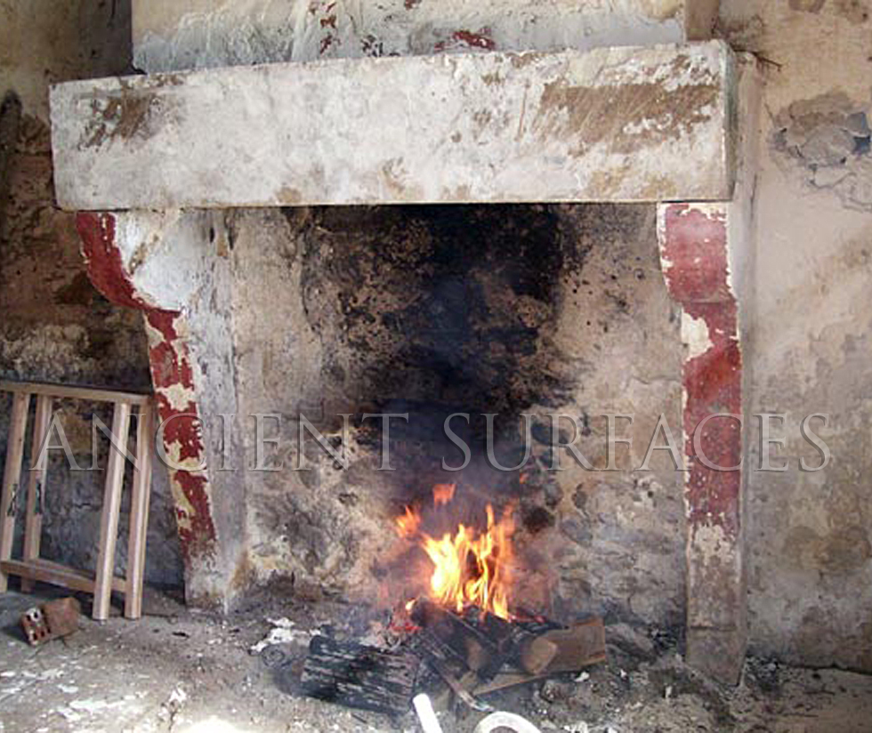 An Antique Stone Fireplace with 3 Layers of Paint, Missing its Top Shelf.