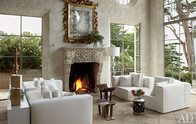 Architectural Digest Magazine April 2011. An antique reclaimed fireplace mantel in Malibu, CA