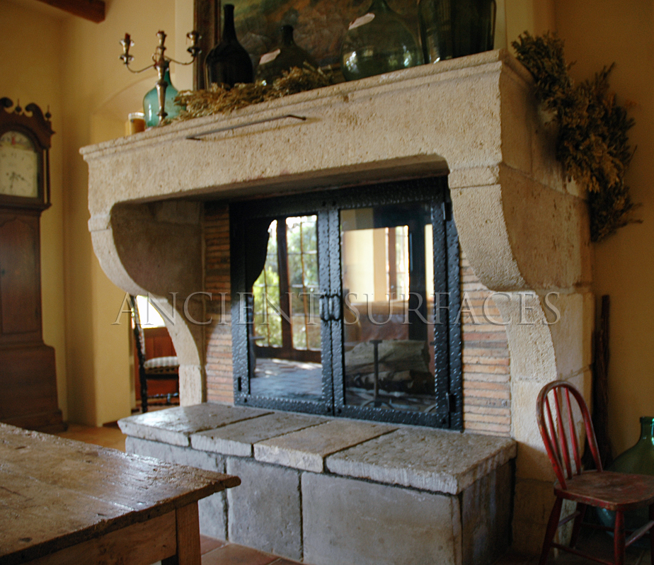 Installed ancient fireplace mantle in a French Provance style home