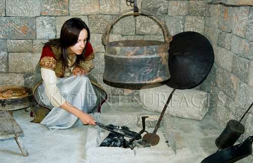 Reenactment in utilization of ancient cooking tools and techniques
