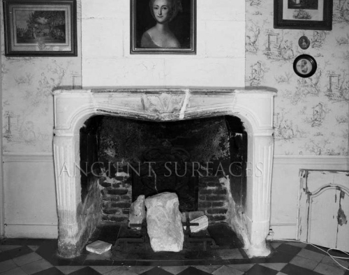 Antique limestone Louis XV fireplace mantle in Situ