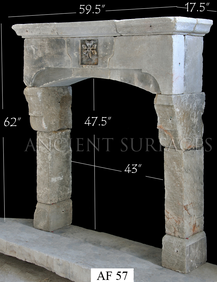 An antique reclaimed Tudor Gothic fireplace mantle by Ancient Surfaces