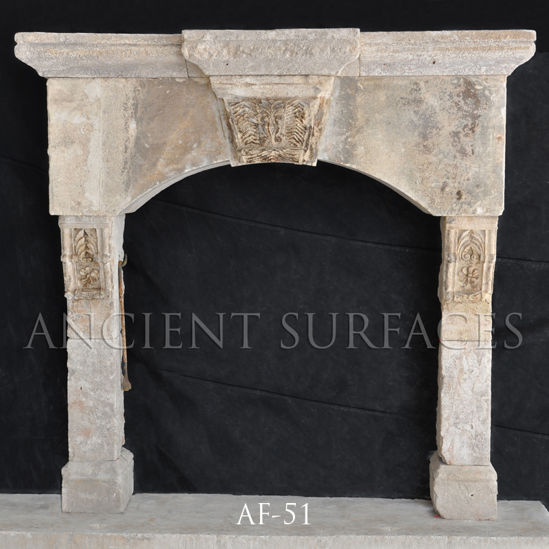 Antique reclaimed stone fireplace mantle from Malta with an English influence