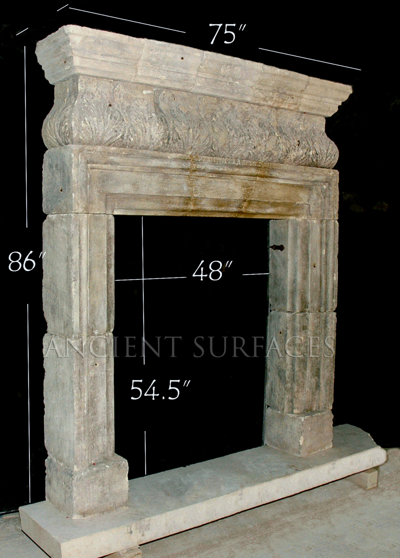 Antique reclaimed English fireplace mantle carved out of stone