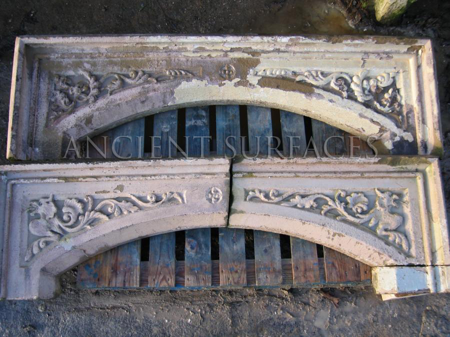 Two Tudor antique reclaimed mantel tops sitting in our salvage yard