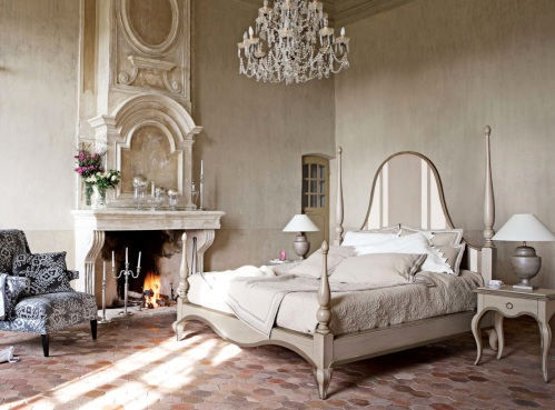 Glamorous bedroom ornate fireplace