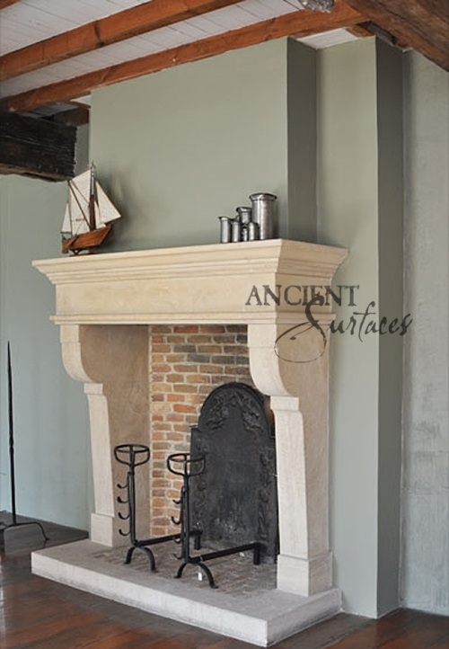 This simple limestone carved fireplace is Tuscan in design installed with a thick stone hearth ad terracotta bricks. Running bond brick are inlay inside the firebox.