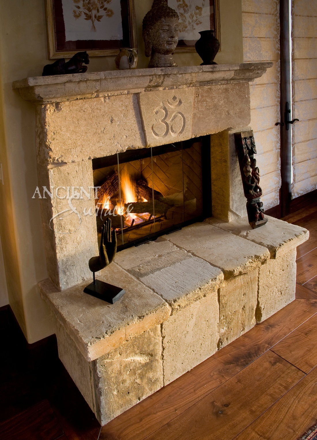 A simple Antique Old World Stone Fireplaces, with the Om yoga sign carved and etched on the center of its keystone by Ancient Surfaces