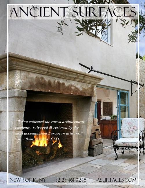 Reclaimed Medieval era antique stone fireplace installed in an outdoor open patio, Coastal California.