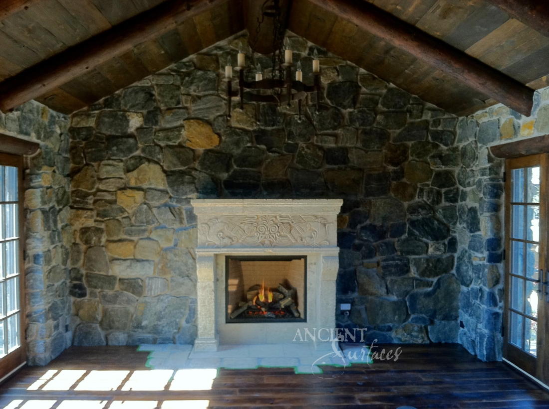 Antique Reclaimed 12th century Limestone Fireplace in its final home in Colorado.