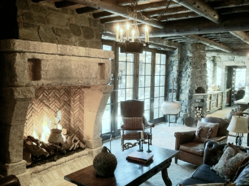 A 12th Century antique Stone fireplace salvaged from the South of France and installed in a Colorado compound.