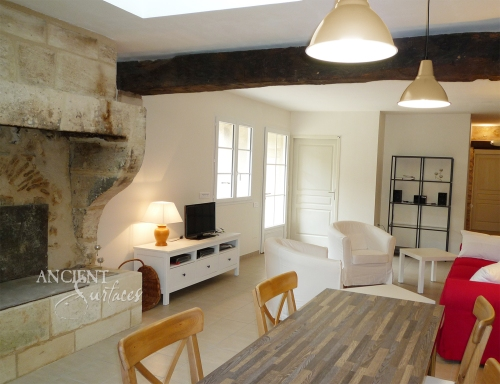 French Limestone Fireplace Mantle with Trumeau by Ancient Surfaces in a Renovated Countryside Vacation House