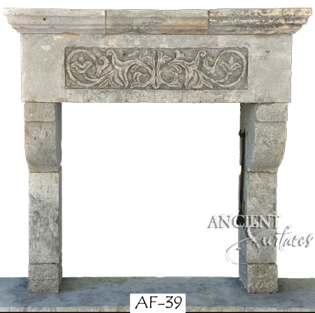 Antique stone fireplace by Ancient Surfaces.