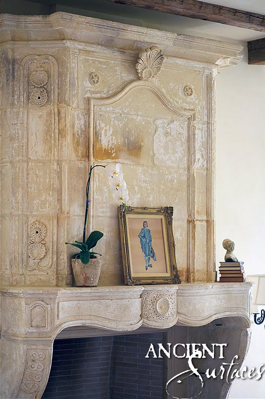 Antique Reclaimed French Fireplace with a decorative over mantle