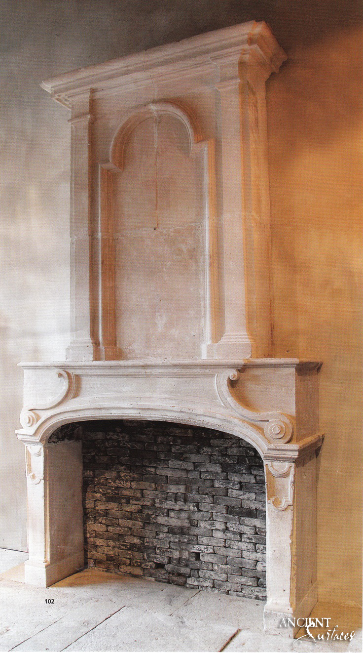 Antique-limestone-fireplace-over-mantel