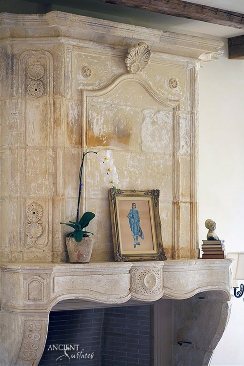 Antique-Reclaimed-French-Fireplace-with-a-decorative-over-mantle