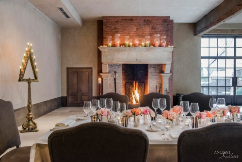 Beautiful-dining-room-with-majestic-antique-limestone-fireplace
