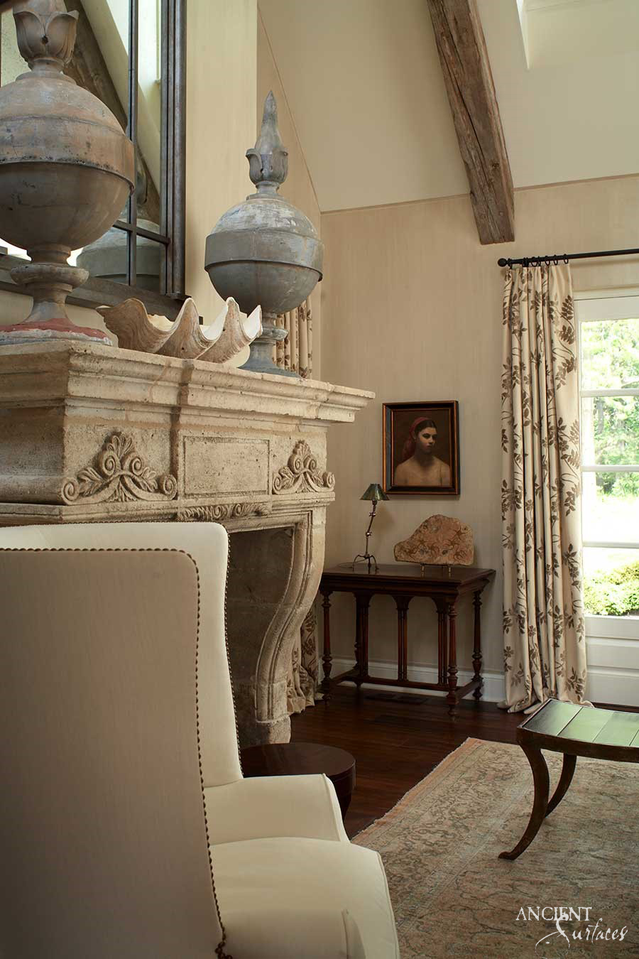 This limestone fireplace is the focal point of this small cottage living room