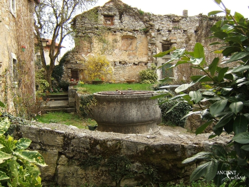 french-farmhouse-garden-limestone-well-head