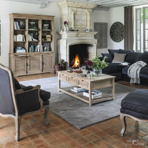 modern-living-room-area-with-a-relcimaed-antique-limestone-fireplace