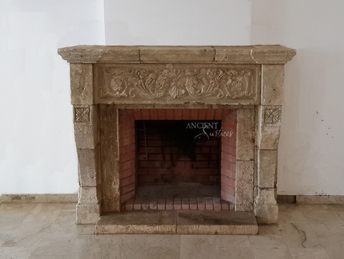 heavy carved limestone fireplace